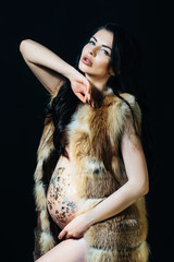 Beautiful and easy pregnancy Long coat on a beautiful pregnant brunette