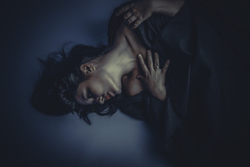 nude brunette woman with black cloth