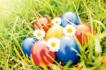 Easter holiday. Colorful Easter eggs in a grass