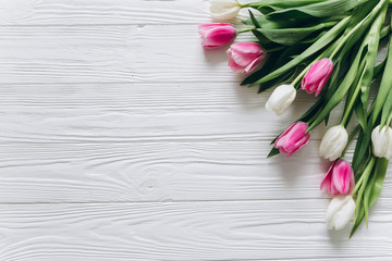 Tulips on a wooden background for Mother's Day.