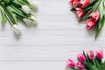 Fresh tulips on a wooden background for Mother's Day.