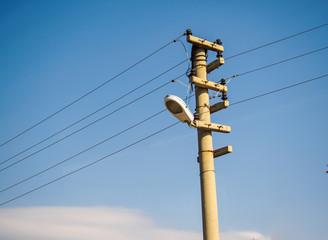 electric pole on blue sky background