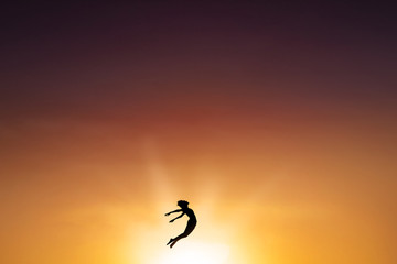Excited woman jumping on the air