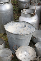 old buckets and other containers in aluminum