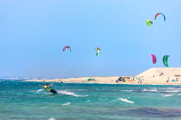 Kitesurfers on the Milos beach in Lefkada island, Greece.