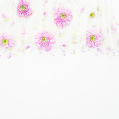 Pink flowers, petals and cloth on white background. Wedding dress. Flat lay, top view. Woman's background
