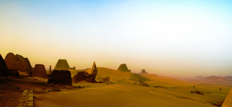 Panorama of Meroe pyramids in the desert at sunset in sand dust , Sudan,