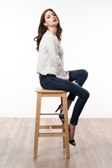 Beautiful model woman sitting on wooden chair