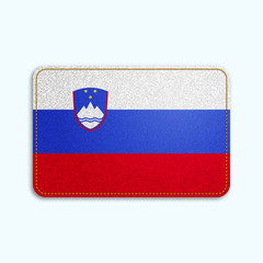 National flag of Slovenia with denim texture and orange seam. Realistic image of a tissue made in vector illustration.