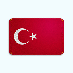 National flag of Turkey with denim texture and orange seam. Realistic image of a tissue made in vector illustration.