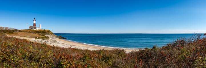 Panoramic view on Montauk Point State Park Lighthouse and the Atlantic Ocean. Long Island, New York State
