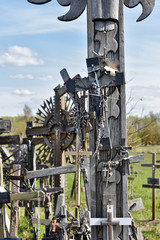Foto op Canvas Grandfailure Hill of Crosses is a unique monument of history and religious folk art in Siauliai, Lithuania. Text on the crosses in different languages - O God, protect our family, give health.