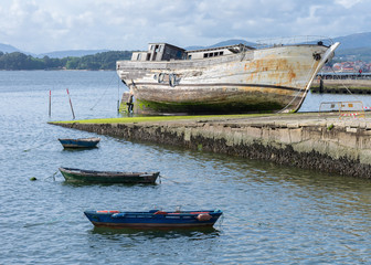 fishing boats and old ship on the quay