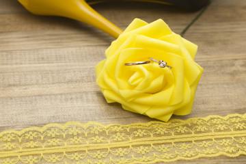 wedding rings inside yellow flower
