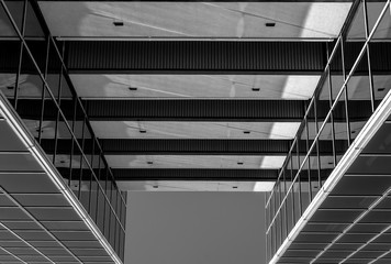 Urban Geometry, looking up to glass building. Modern architecture, glass and steel. . Abstract architectural design. Inspirational, artistic image.Minimal art. Architectural design. Building exterior.