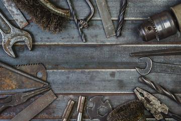 Old tool on rusty old metal slats. Copyspace