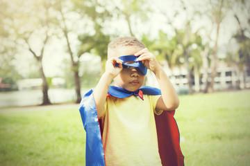 Little kid in super hero costume sneak peeking