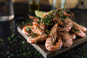 Delicious king prawns on wooden board
