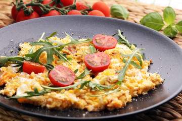 Traditional breakfast - fried eggs,ruccola, tommato- - diet concept scrambled eggs