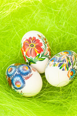 Easter eggs on green like grass background