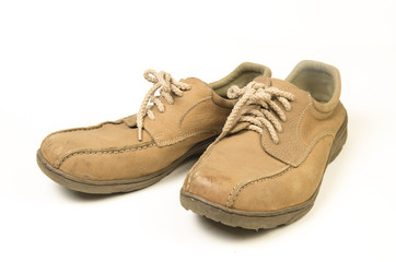 Brown leather men's shoes with wooden shoe stretchers on the side