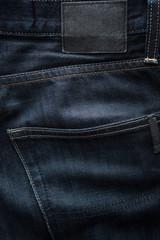 Dark blue jeans fabric background