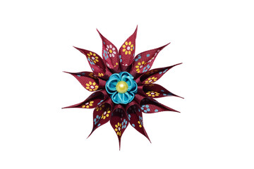 Wall Mural - Kanzashi. Blue artificial flower on maroon star isolated on whit