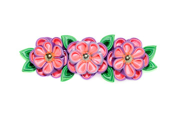 Wall Mural - Kanzashi. Violet artificial flowers isolated on white background.