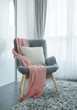 Pink scarf on dark gray vintage style armchair in the living room