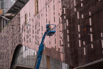 Crane worker working exterior wall