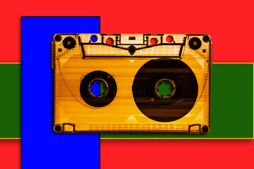 Picture of a musical cassette on a colorful background