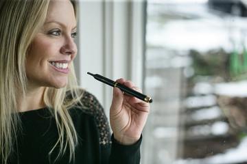 Close up of young woman smoking cannabis at home