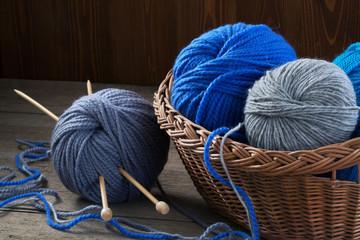 Knitting yarn, knitting needles and wicker basket