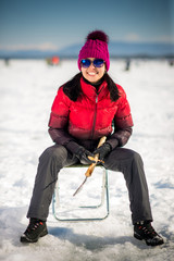 Woman ice-fishing in the winter