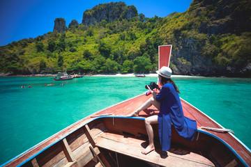 Happy female traveling on boat, Krabi Thailand
