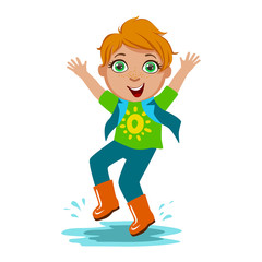 Boy In T-Shirt And Rubber Boots, Kid In Autumn Clothes In Fall Season Enjoyingn Rain And Rainy Weather, Splashes And Puddles