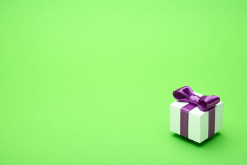 Gift with a bow on a green