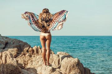 beautiful boho woman in bikini on the beach
