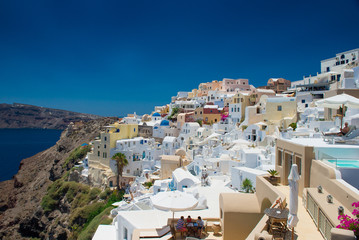 Architecture of island of Santorini, the most romantic island in the world, Greece. Hotels in Santorini. Walking the streets of Fira summer day, Travel to Greece. Beautiful white exterior Santorini