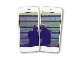 Backside of lover being close and looking to lake photo on two smartphone screen isolate on white baclground, Clipping path
