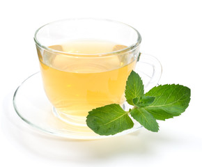Green tea in transparent cup with mint leaves isolated on white