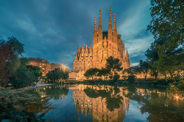 Barcelona, Catalonia, Spain: Basicila and Expiatory Church of the Holy Family, known as Sagrada Familia at sunset