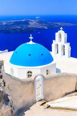 Wall Mural - Santorini, Greece. Blue dome Church St. Spirou in Firostefani village.