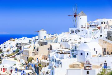 Fototapete - Santorini, Greece. Windmills of Oia (Ia) village.