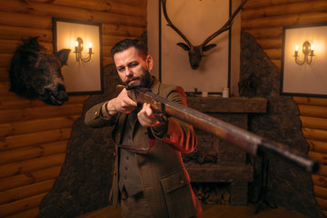 Hunter man aims of the antique hunting rifle