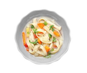 Chicken noodle soup in plate on white background
