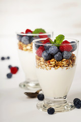 Freshly prepared yogurt parfait with fresh fruit and mint