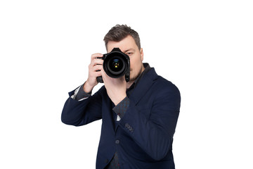 Photographer with digital camera taking picture