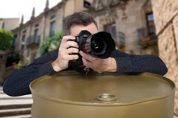 Photographer takes a picture leaning on barrel