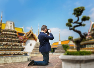 Male camerist taking picture of the temple